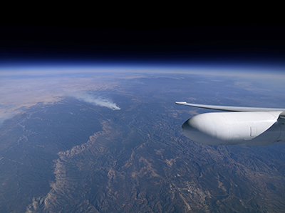 The ER-2 pilot's view of controlled forest fire burns in Arizona. Credit: NASA/Stu Broce