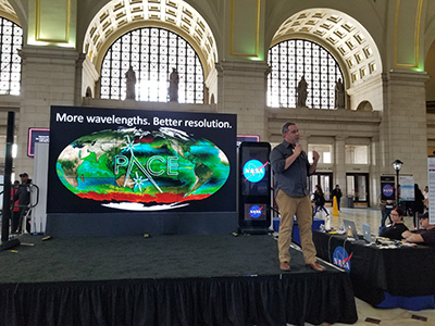 PACE Project Scientist Dr. Jeremy Werdell concludes a hyperwall talk that he presented for a public audience at the NASA Earth Day event in Washington, D.C. Credit: NASA/PACE