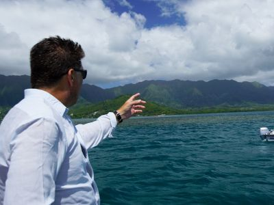 Principal Investigator Eric Hochberg directs sampling efforts during the CORAL field campaign.