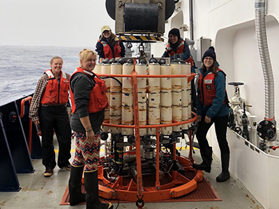 Scientists prepare to deploy a Conductivity, Temperature, and Depth (CTD) sensor, which generates a vertical profile of the water column (surface to bottom). Discrete water samples are collected for analysis via a rosette of Niskin bottles. Credit: NASA