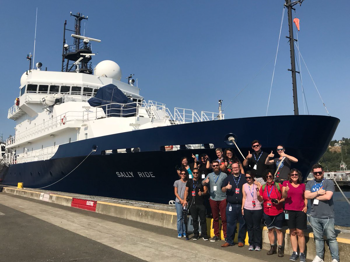 Participants from a NASA social media event pose by the R/V Sally Ride