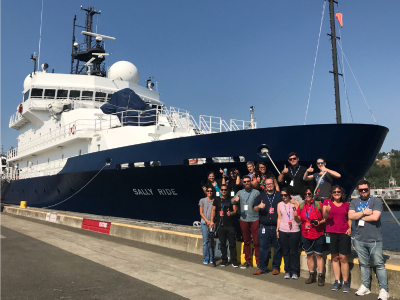 Participants from a NASA Social event pose by the R/V <em>Sally Ride</em> before it embarks on its August 2018 tour of the North Pacific as part of the EXPORTS field campaign. Credit: NASA