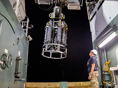 A CTD and water sampling system rosette is prepared for deployment on the R/V <em>Falkor</em>. Credit: Schmidt Ocean Institute
