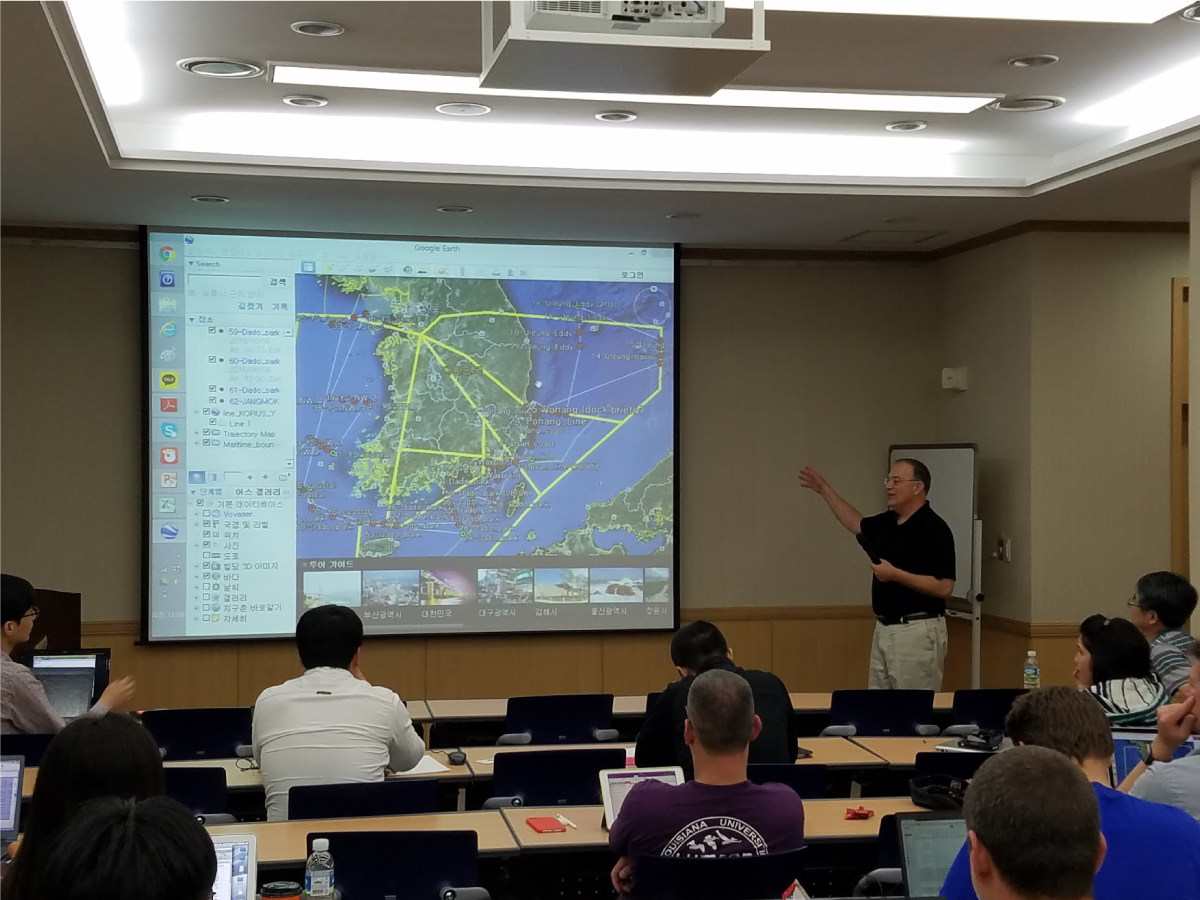 Scientists discuss the combined ship-based and airborne tracks for the field campaign