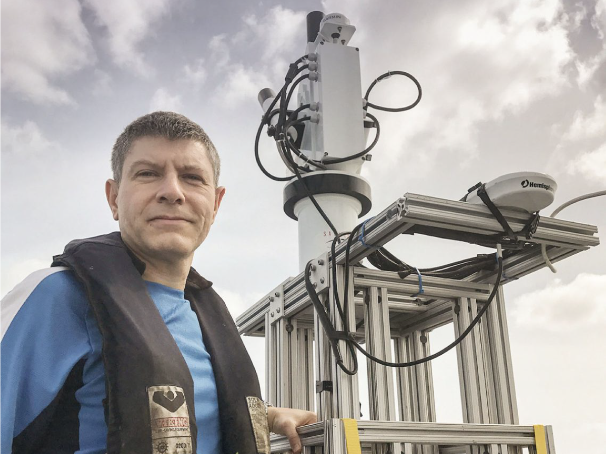 Dr. Antonio Mannino stands next to the HypeSAS radiometer