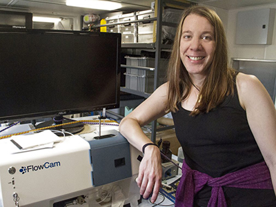 Aimee Neely uses a FlowCam to study particles suspended in seawater