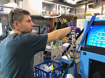 Antonio Mannino measures rates of biological processes for the Sea to Space Particle Investigation. Credit: Schmidt Ocean Institute